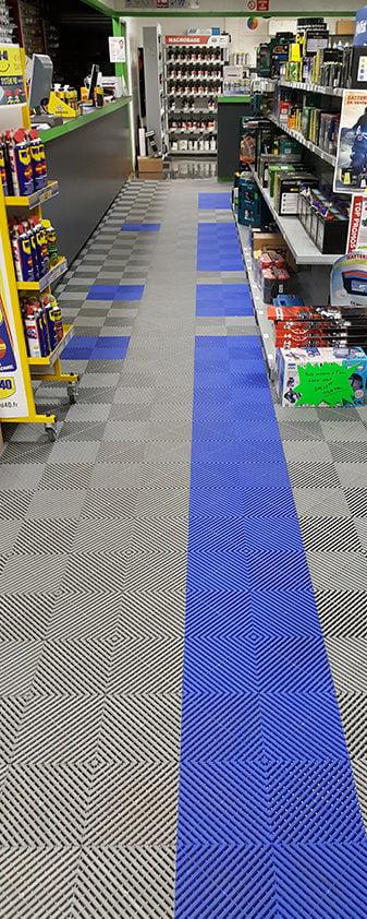 dalles de sol bleues Polydal pour merchandising